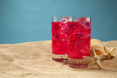 Cold drinks on the beach Royalty Free Stock Images
