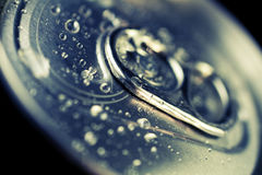 Cold drinks can, closeup. Closeup on the lid of a cold drinks can with condensation drops on the top. Cross-processed macro shot Royalty Free Stock Photography