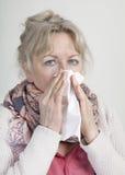 Cold elderly woman Stock Image