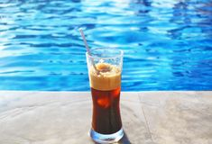 Cold espresso coffee in front of the swimming pool - summer resort Greece Stock Photo