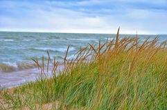 Cold, fall day. Waves are rolling in on a cold, windy fall day royalty free stock photo