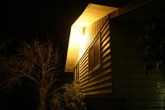 Cold fall night with porch light on Royalty Free Stock Images