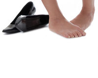 Cold feet. Ladies feet and shoes on a white background Royalty Free Stock Photo