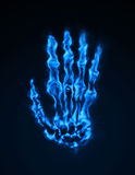 Cold Fire Hand. Skeleton hand made of blue fire Stock Photo