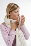 Cold and Flu. Young woman coughing isolated on white Stock Image
