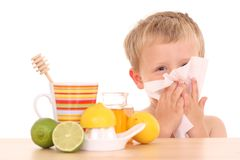 Cold and flu. 3-4 years old boy with cold and flu remedy on white