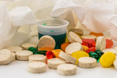 Cold and flu over the counter medications. Cold and flu season medicines for cough, sneeze, and sore throat Stock Photography