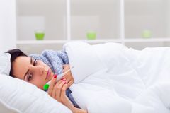 Cold And Flu. Portrait Of Ill Woman Caught Cold, Feeling Sick An. D Sneezing In Paper Wipe. Closeup Of Beautiful Unhealthy Girl Covered In Blanket Wiping Nose royalty free stock photography