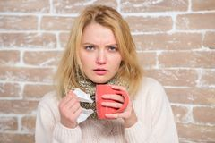 Cold and flu remedies. Drink more liquid get rid of cold. Drinking plenty fluid important for ensuring speedy recovery. From cold. Girl hold tea mug and tissue stock images