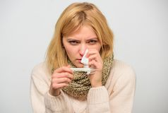 Cold and flu remedies. High temperature concept. Take temperature and assess symptoms. Measure temperature. Woman feels. Badly ill sneezing. Girl in scarf hold stock photography