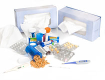 Cold and Flu Season. A studio concept shot of the cold and flu season showing various cold medicines, tissue boxes and thermometers Stock Image