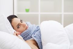 Cold And Flu. Woman sleep and hold her head with subliminal stre Stock Images