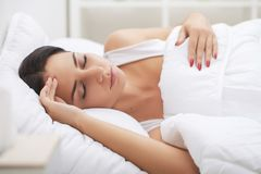 Cold And Flu. Woman sleep and hold her head with subliminal stre Stock Photo