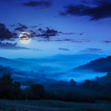 Cold fog on blue night in mountains. Cold night fog in  full moon light in the mountains Stock Photos