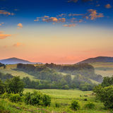 Cold fog on hot sunrise in mountains Stock Photos
