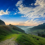 Cold fog on hot sunrise in mountains Stock Photography