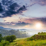 Cold fog on hot sunset in mountains Royalty Free Stock Images