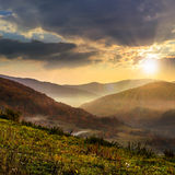 Cold fog in mountains at sunset Royalty Free Stock Image