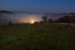 Cold fog before sunrise in mountains Royalty Free Stock Images