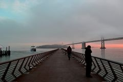 Cold and Foggy morning at Pier 14. This photo was taken last January 9, 2019 near the San Francisco Oakland Bay Bridge. It was a very cold and very foggy morning royalty free stock photo