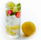 Cold fresh cocktail drink lime lemon fruits on white background Royalty Free Stock Photos