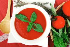 Cold fresh diet tomato soup with basil Royalty Free Stock Photos