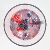 Cold fresh drink with fruits and ice. Summer refreshment. Water in glass. Royalty Free Stock Photo