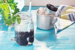 Cold fresh lemonade with blackberry stock image