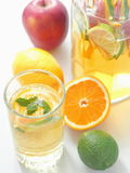 Cold fresh lemonade drink. Refreshing summer sangria. Homemade punch with fresh fruits and mint leaves Stock Image