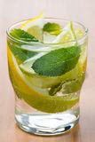 Cold fresh lemonade with lemon, lime Stock Photography