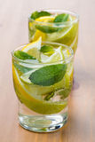 Cold fresh lemonade with lemon, lime and mint Royalty Free Stock Image