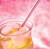Cold fresh lemonade  on  pink background. Cold fresh with ice lemonade  on pink background Royalty Free Stock Photo