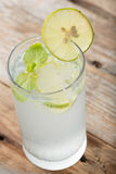 Cold fresh lemonade soda drink on a wooden. Royalty Free Stock Image