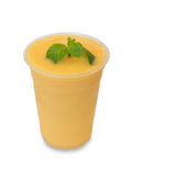 Cold fresh mango smoothie in takeaway glass on white Royalty Free Stock Images