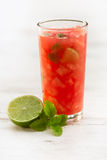 Cold fresh watermelon juice. With mint leaves and lime citrus Stock Photography