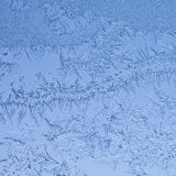 Cold frost background. Frosty winter background photo of ice buildup on a window Stock Photos