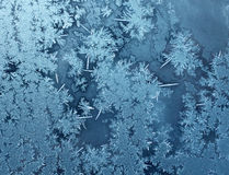 Cold frost background. Frosty winter background photo of ice buildup on a window Royalty Free Stock Photography