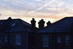 Cold and frosty morning. Frost on roofs on a cold morning stock image