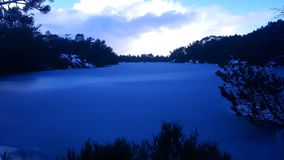 Frozen lake. Cold frozen lake in the forest Stock Images