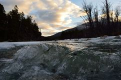 Cold frozen mountain creek with ice Stock Photography