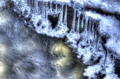 Cold frozen mountain river stream in the cold winter forest in the deep arctic circle wilderness Stock Photo