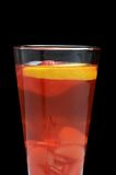 Cold fruit tea with an orange Royalty Free Stock Image
