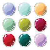 Cold gamma colored buttons with glass surface effect. Blank  buttons set for web design or game graphic. Colorful marbles on white background. Empty bubbles Royalty Free Stock Photos