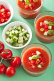 Cold gazpacho soup in glass and ingredients Royalty Free Stock Image