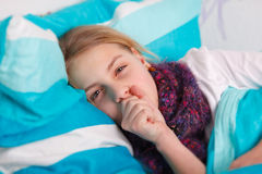 Cold. Girl lying sick in bed Stock Photo