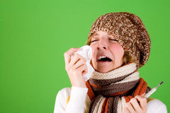 Cold girl sneezes royalty free stock photos