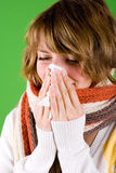 Cold girl sneezes Royalty Free Stock Photography