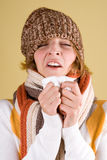 Cold girl sneezes Royalty Free Stock Photo