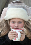 Cold girl with warm drink Stock Photography
