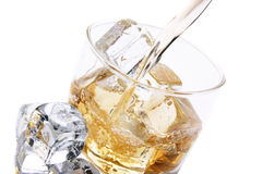 Cold glass of alcohol. Glass of ice and alcohol Stock Photography